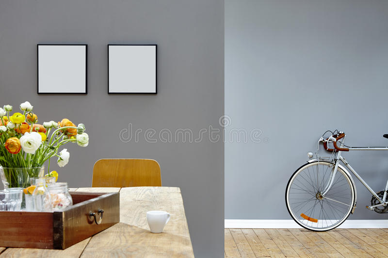 Modern interior vintage look table and bike in two rooms. Colorful floral decoration stock photos