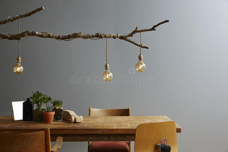 Modern interior wooden furniture and design lamp branch and bulbs royalty free stock photography