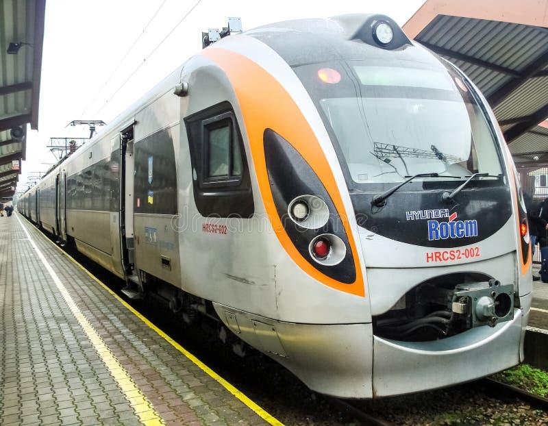 Modern international train Lviv-Przemysl on platform. Ukraine-EU Poland railroad transport communication. stock images
