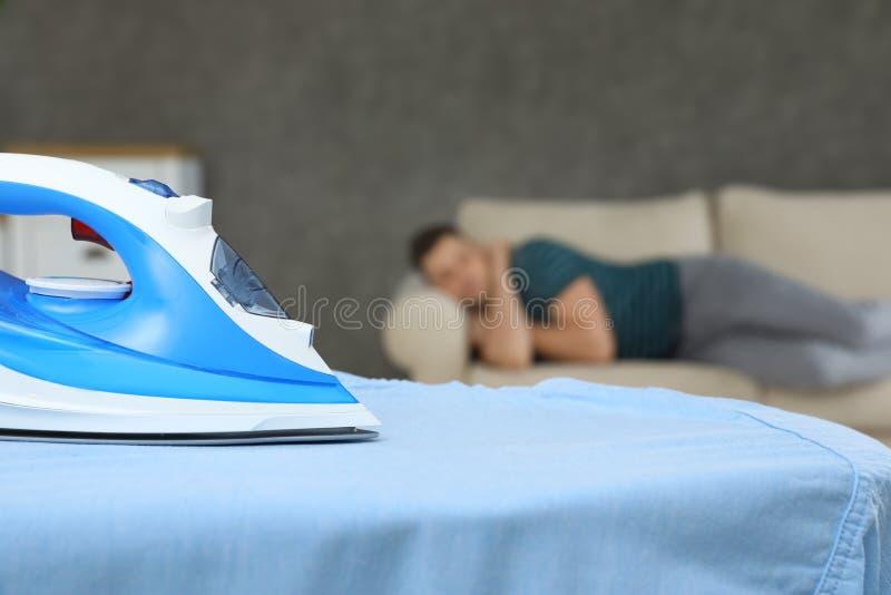 Modern iron and sleeping man in room stock photo