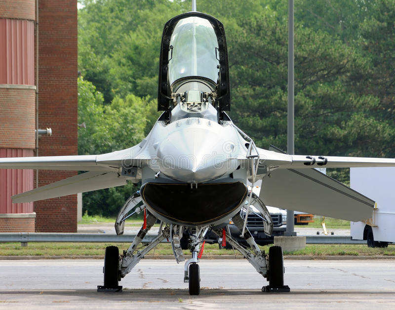 Modern jetfighter. Modern fighter jet on the ground front view royalty free stock images