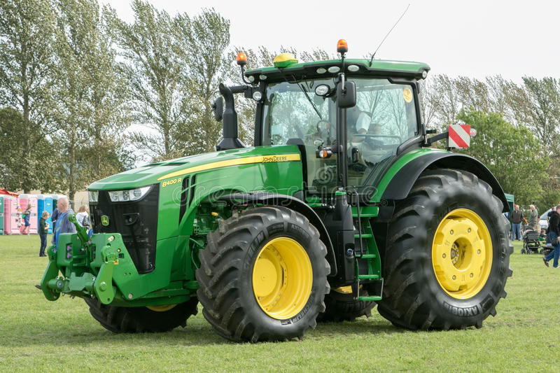 Modern John Deere tractor parked at a show. Modern 8400 John Deere tractor parked at a show with farmer stock images