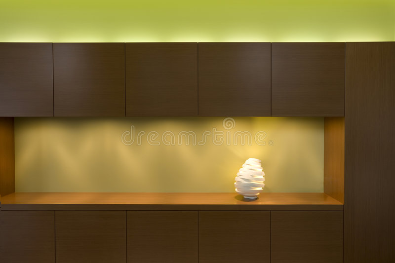 Modern joinery. Wood veneer modern joinery with lamp stock image