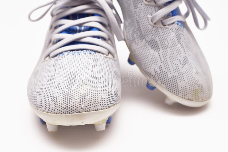 Modern Kid Soccer Shoes Isolated. On A White Background Photo Taken With Flash royalty free stock photo