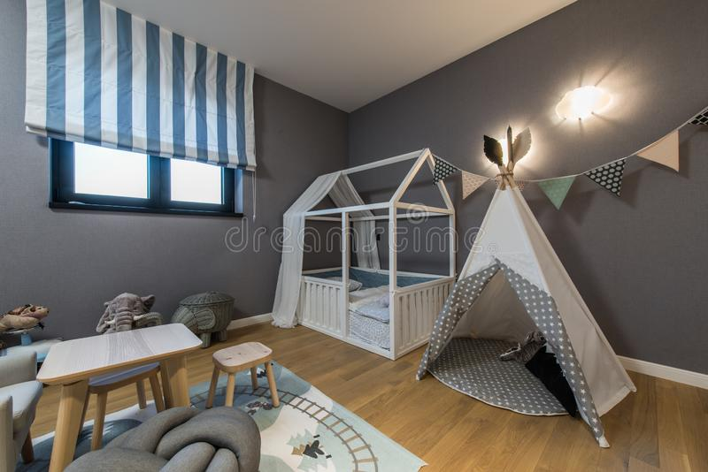 Modern kids room with tent royalty free stock photos