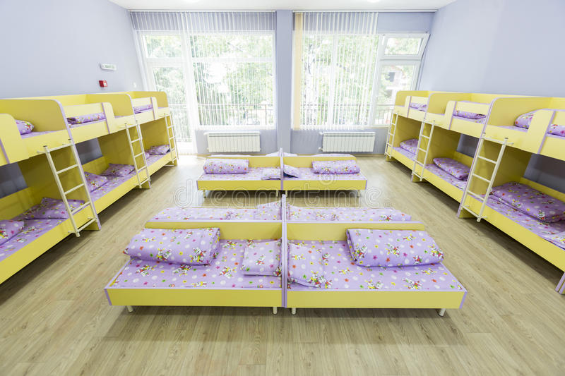 Modern kindergarten bedroom with small beds stock photo