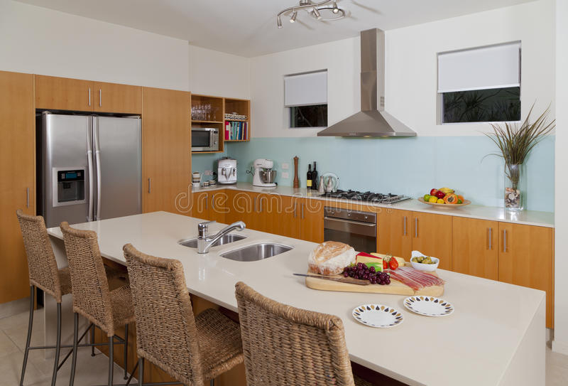 Modern kitchen. With food and fruit platter royalty free stock photo