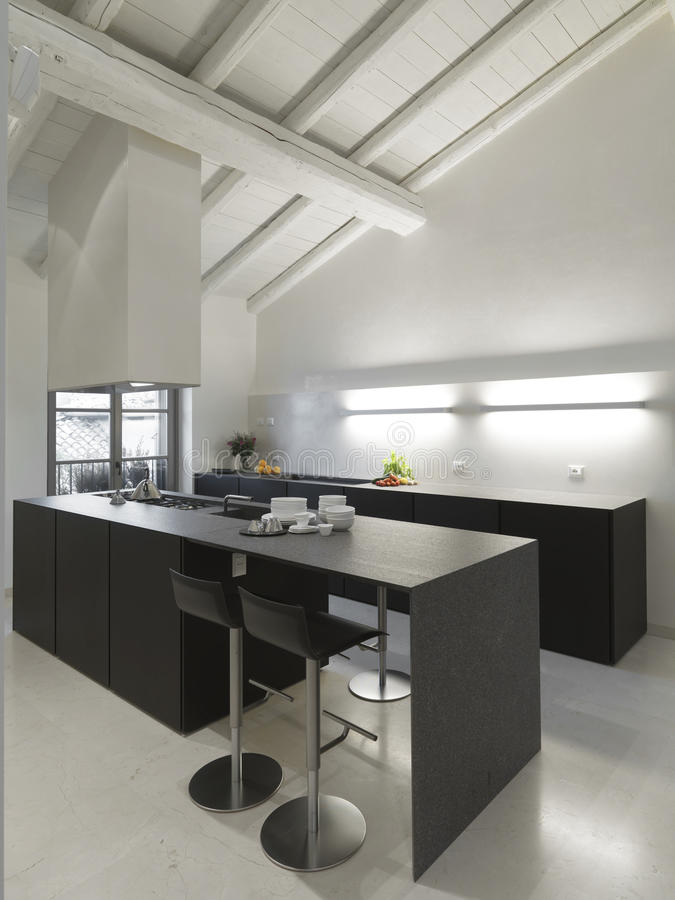 Modern Kitchen In The Attic Royalty Free Stock Images