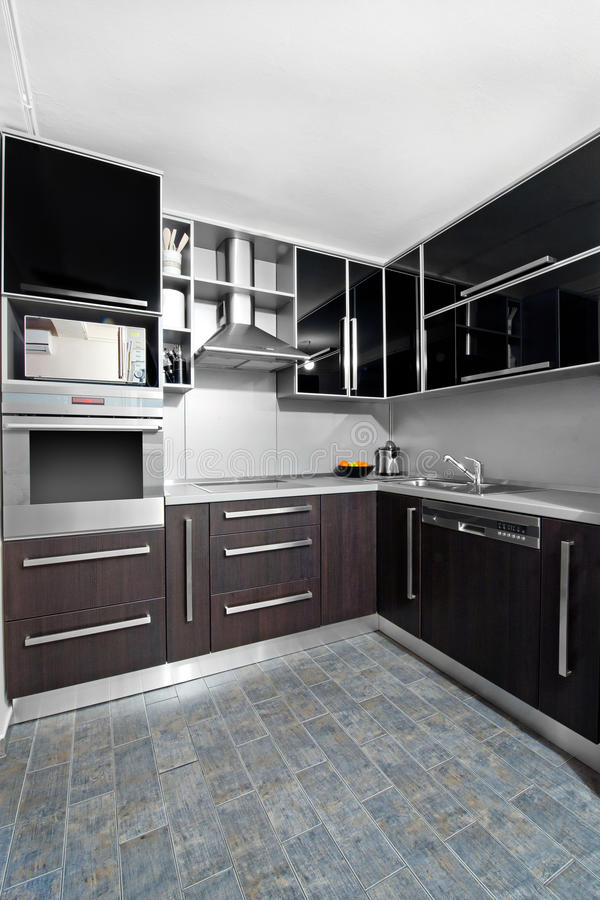 Modern kitchen in black and wenge colors stock photo for Wenge kitchen designs