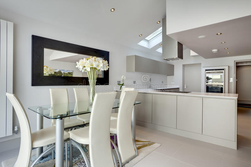 Modern kitchen and breakfast room royalty free stock photo