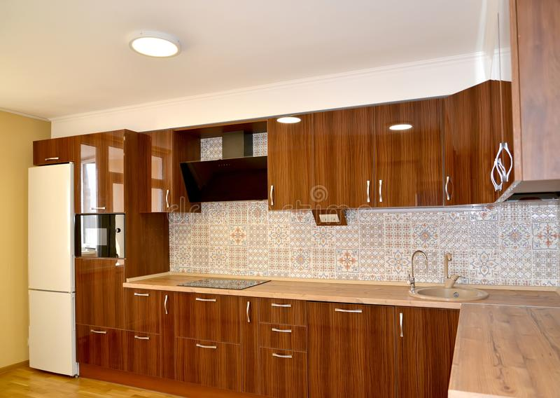 Modern kitchen with the built-in furniture and household appliances.  stock images