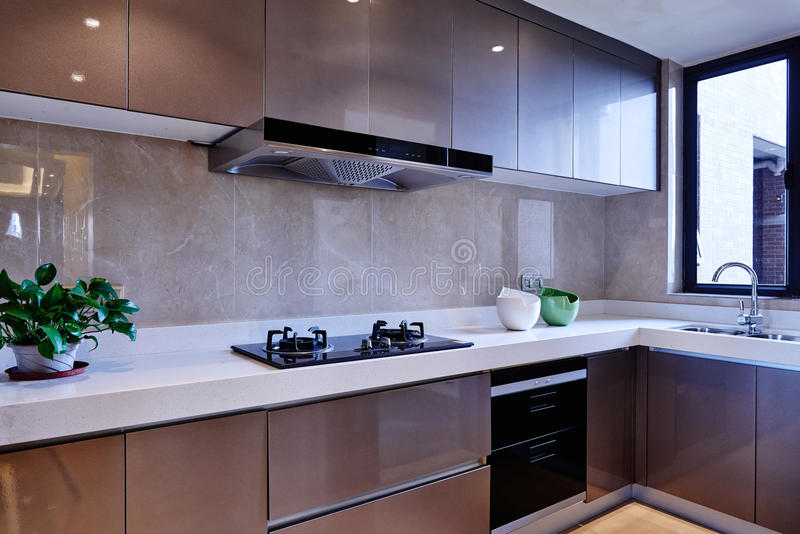 Modern kitchen. Modern and concise kitchen in new home stock image