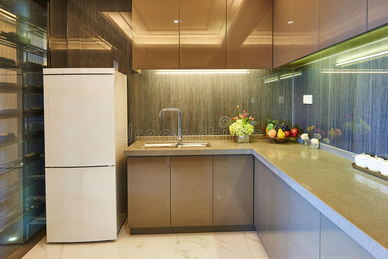Modern kitchen. Modern concise kitchen in new house stock photo