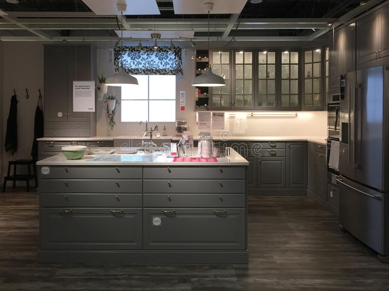 Modern kitchen design with island at furnishing store IKEA. Nice modern kitchen furniture for sale at store IKEA, TX USA royalty free stock photo