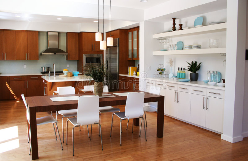 Modern kitchen and dining area stock photos