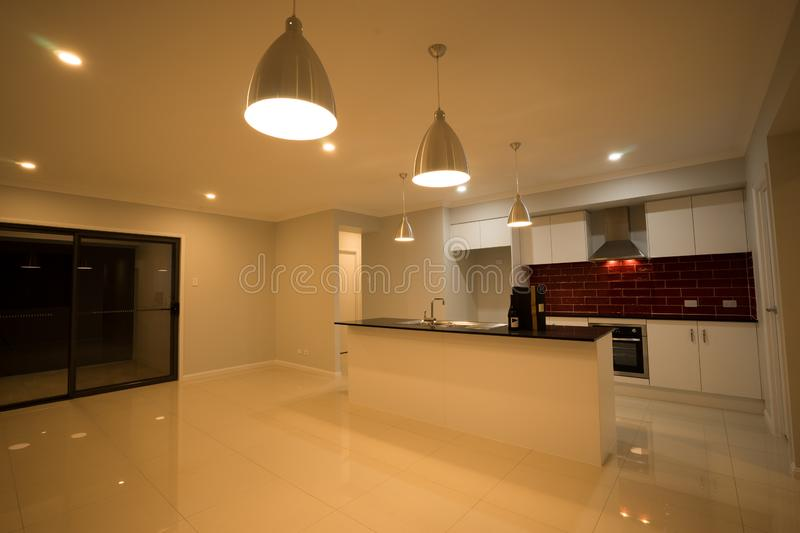 Modern Kitchen And Dining Area Design royalty free stock images
