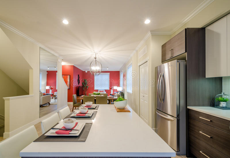 Modern kitchen and dining room stock photos
