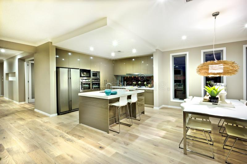Modern kitchen and dinning area interior view of a house royalty free stock photography
