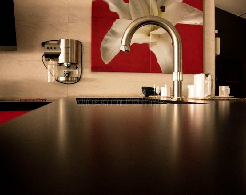Modern kitchen faucet royalty free stock photos