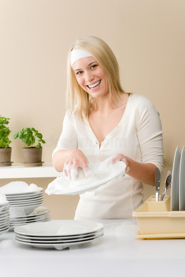 Modern Kitchen - Happy Woman Washing Dishes Royalty Free Stock Photos