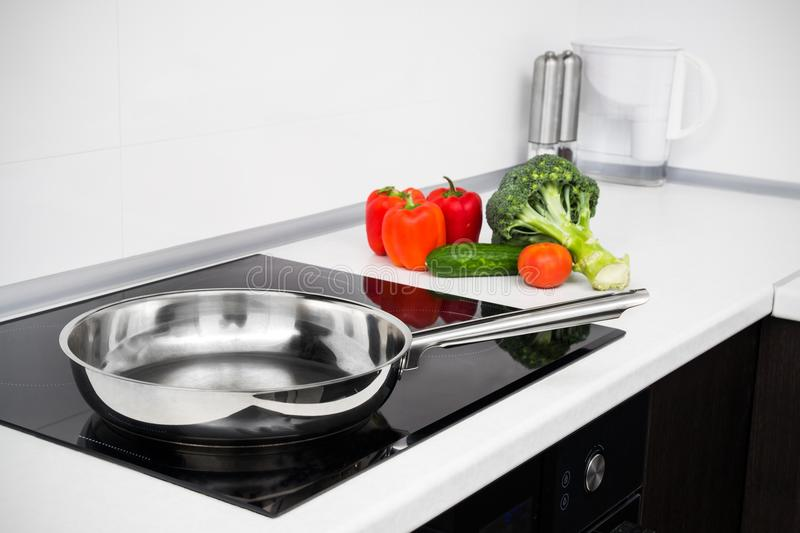 Modern kitchen with induction stove stock photography