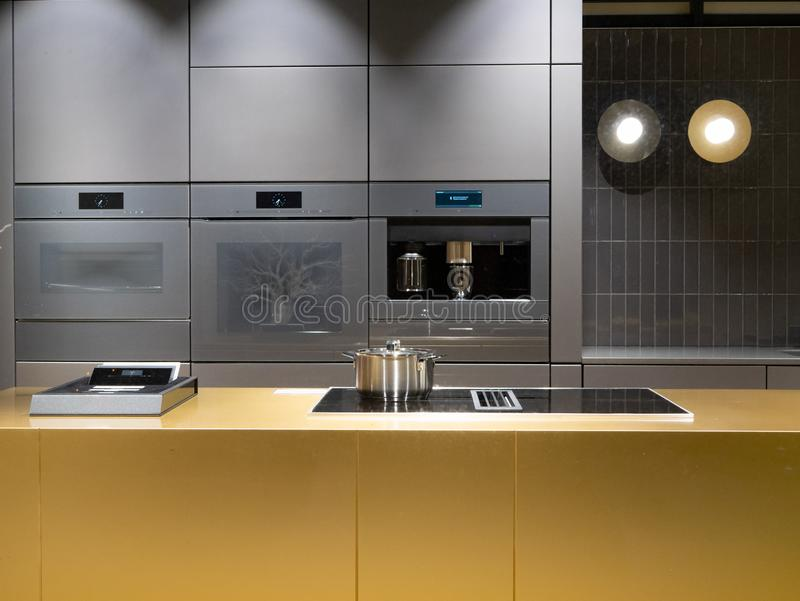 Modern kitchen interior dim low light evening image. Indoor house home royalty free stock photo