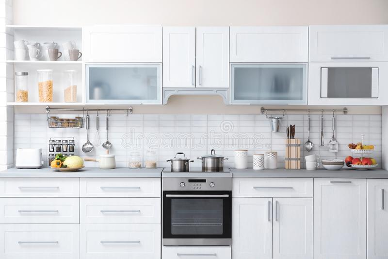 Modern kitchen interior with houseware royalty free stock photos