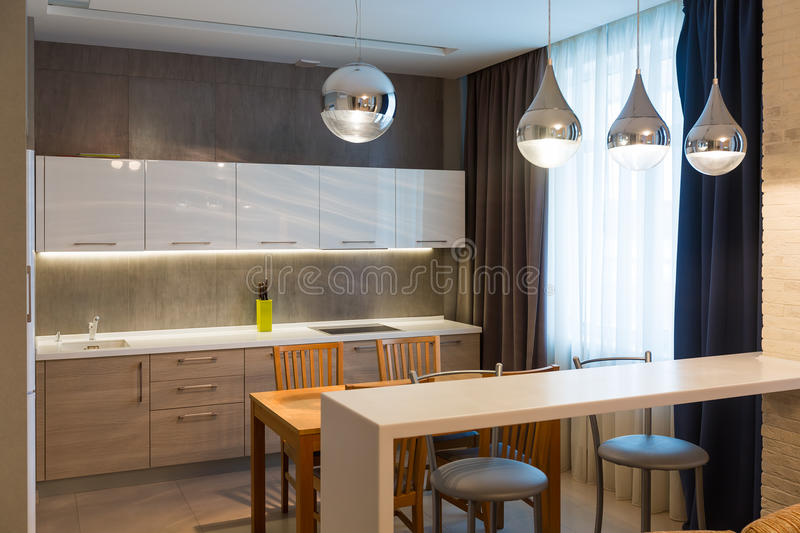 Modern kitchen interior in new luxury home, apartment. Bright royalty free stock photography