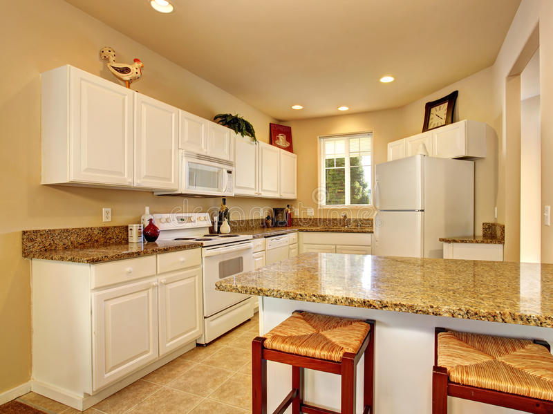 Modern kitchen with marble counters and beautiful decor. stock photos