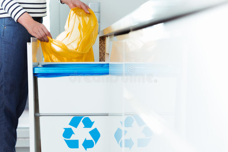Modern kitchen with recycling bin stock photography