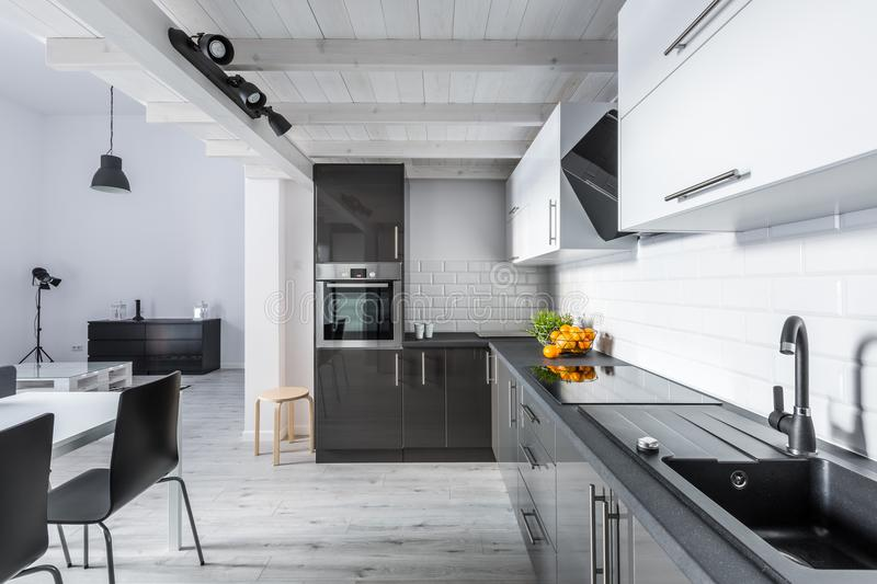 Modern kitchen with rustic ceiling royalty free stock photos