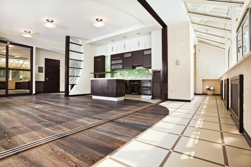 Modern kitchen (studio) interior with balcony royalty free stock photos