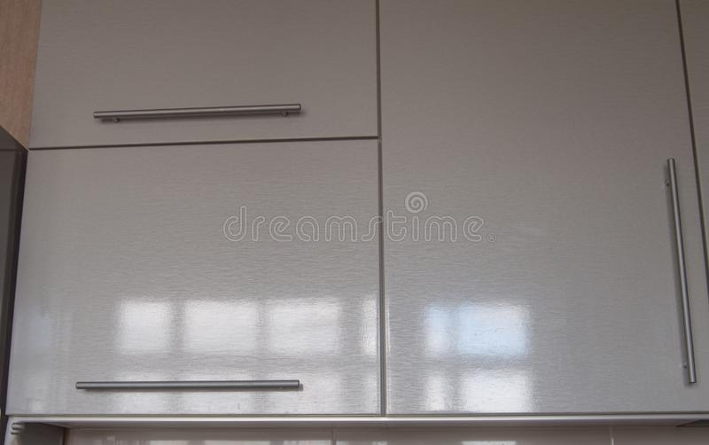 Modern kitchen wall Cabinet silver in the interior of the kitchen in the style of minimalism royalty free stock photos