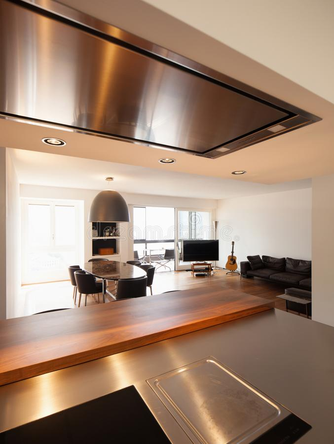 Beautiful kitchen and living in luxury apartment stock photography