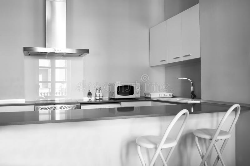 Modern kitchen. A modern, white kitchen in a italian home stock image