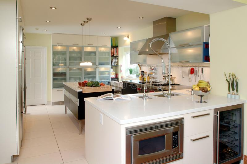 Modern kitchen with white counter top royalty free stock photography