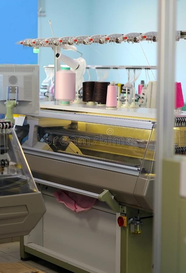 Computerized knitting machines. Modern Knitting machine in the factory royalty free stock photography