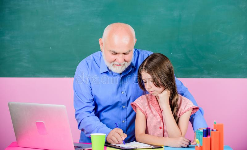 Modern knowledge. Modern education. Happy student. Senior teacher and girl at school lesson. Modern teaching method stock photography