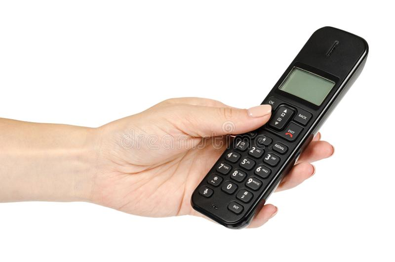 modern landline cordless phone with hand, old technology concept royalty free stock images