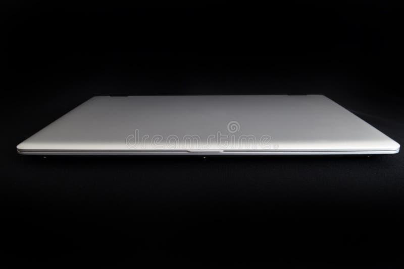 Modern laptop on black. Background stock photos