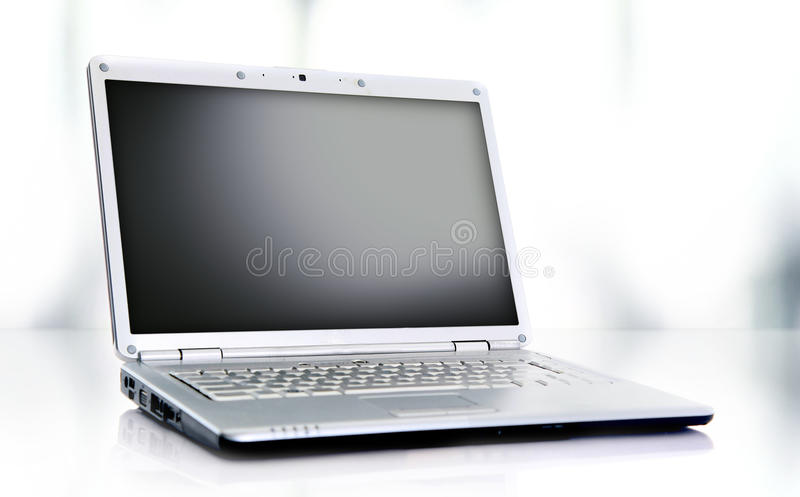 Modern laptop isolated on white with reflections o royalty free stock photography