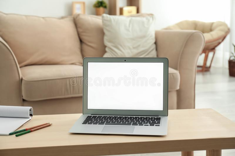Modern laptop on table in room royalty free stock image