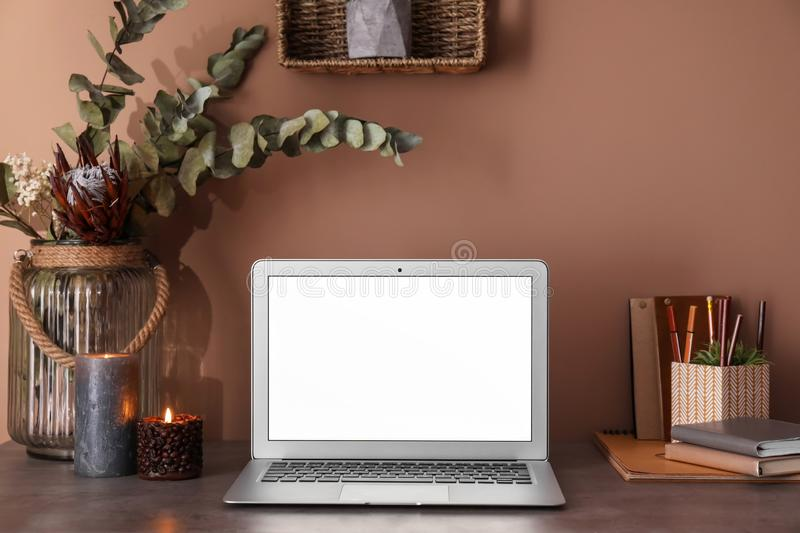 Modern laptop on table in room royalty free stock photos