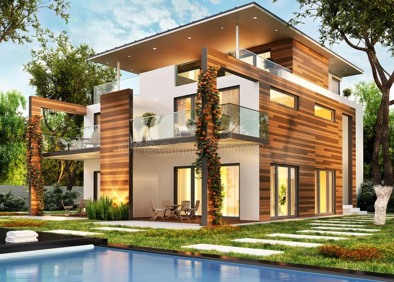 Modern large house with lighting and pool royalty free stock image