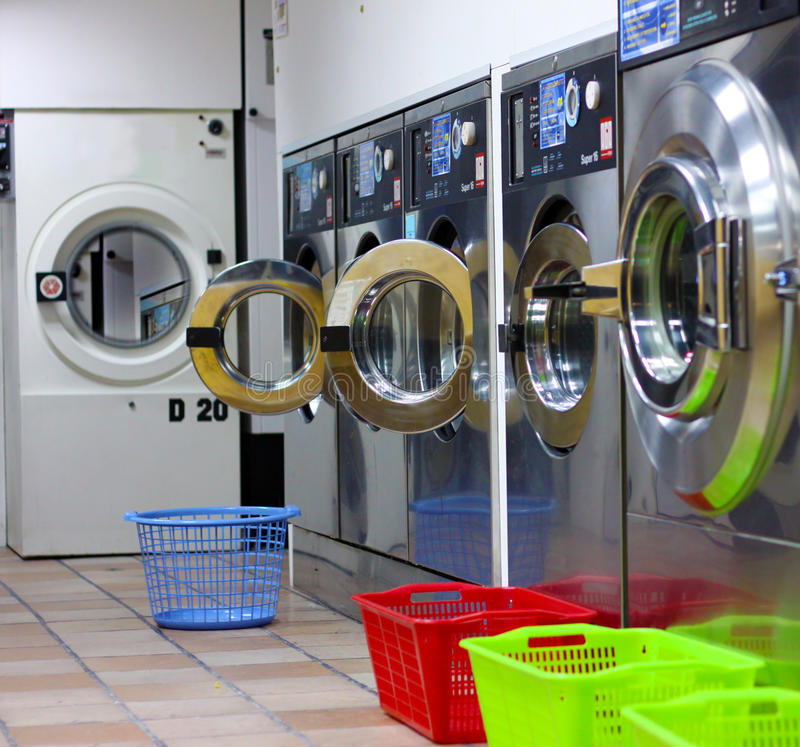 Modern laundry room. Laundry room with four washing machines