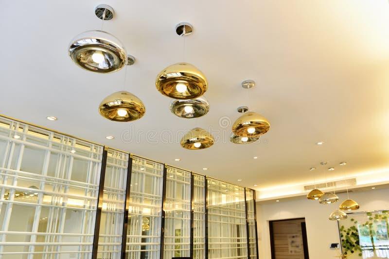 Modern home led chandelier lighting. Modern led chandelier lighting in house living room stock photos