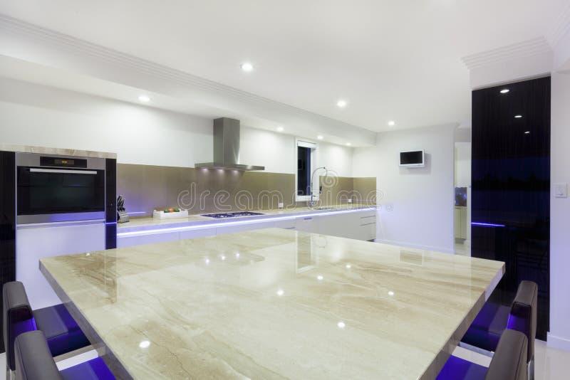 Modern LED lit kitchen royalty free stock image