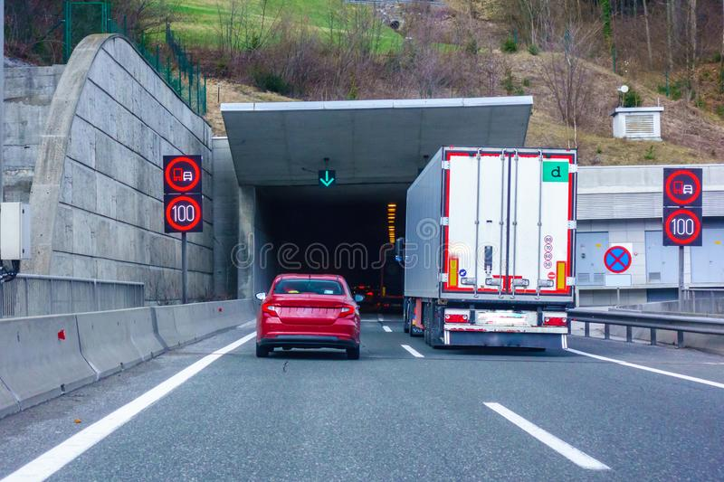 Modern LED traffic signs on highway, red car, truck on road. Modern LED traffic signs on Slovenian highway A1 near Trojane, red car, truck on road entering royalty free stock image