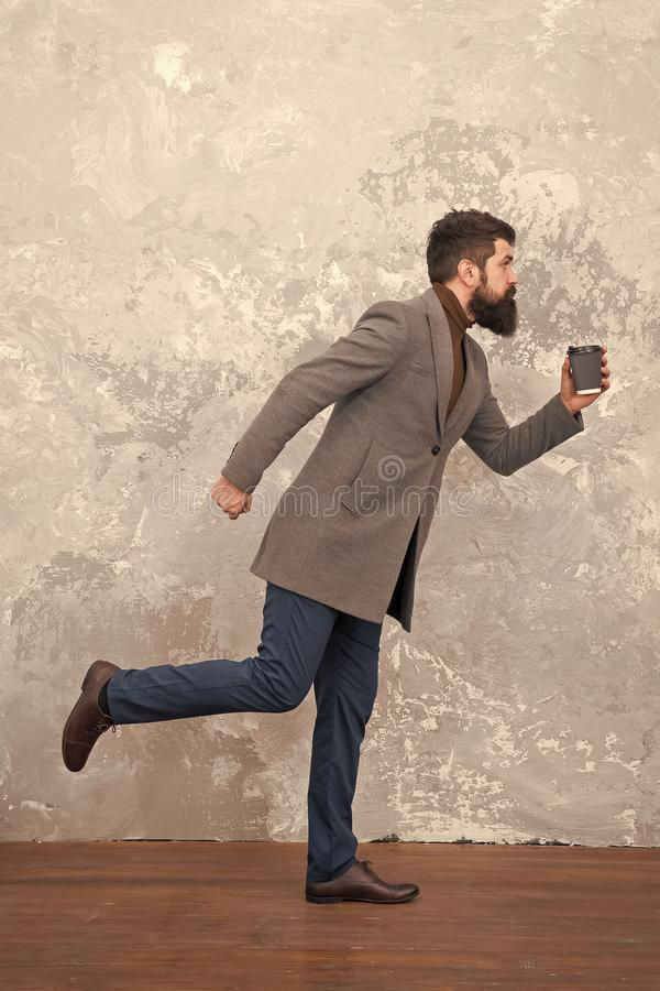 Modern life. Male fashion model. Mature businessman drink take away coffee. Brutal bearded hipster in denim wear. trendy stock photography
