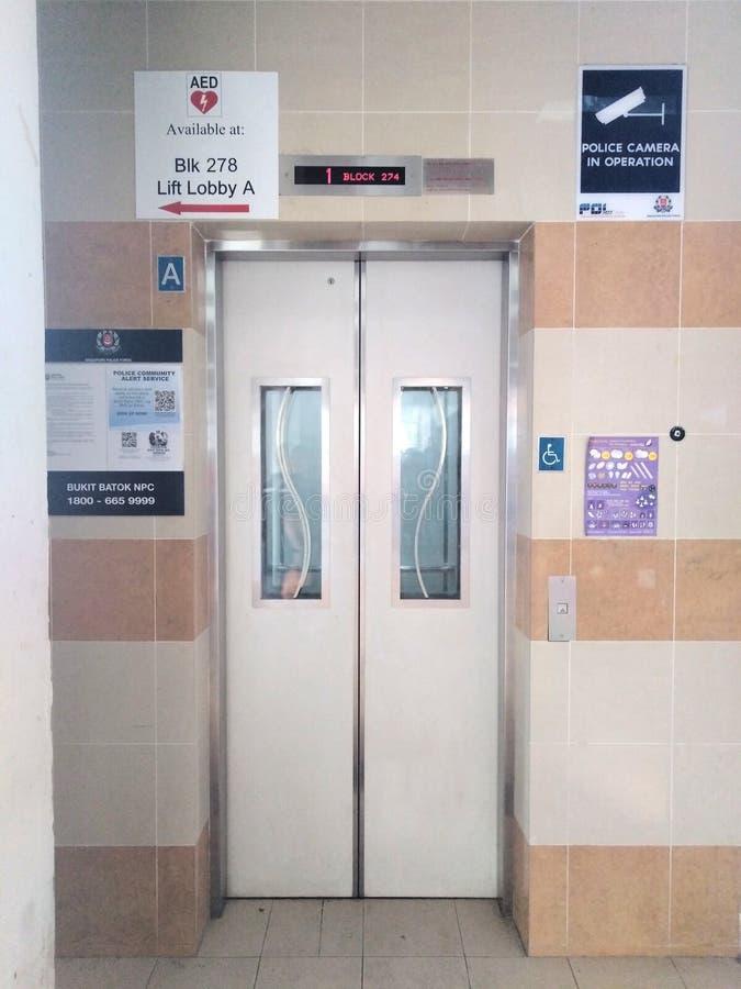 Modern lift lobby in residential block. Modern lift lobby in a residential block in singapore, ground, floor, hdb, flat, apartment, public, housing, estate stock images